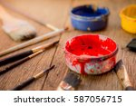 closeup of red and paintbrush | Shutterstock . vector #587056715