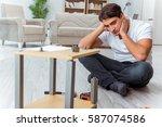 man assembling furniture at home | Shutterstock . vector #587074586