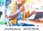joyful african american man... | Shutterstock . vector #587075018