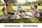 family picnic outdoors... | Shutterstock . vector #587094806
