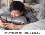 young lazy man lying down on... | Shutterstock . vector #587118662