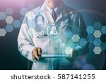doctor with stethoscope and... | Shutterstock . vector #587141255