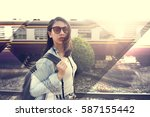 woman traveler with the train... | Shutterstock . vector #587155442