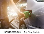 grey car at gas station being... | Shutterstock . vector #587174618