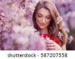 beautiful young woman near the... | Shutterstock . vector #587207558