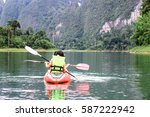 Two Women Kayaking In...