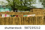 reed fence in front of a house... | Shutterstock . vector #587235212