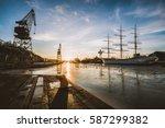 cranes in golden sunset... | Shutterstock . vector #587299382