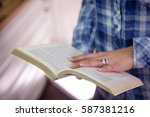 person reading book. close up... | Shutterstock . vector #587381216
