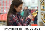 woman buys sunflower oil in... | Shutterstock . vector #587386586