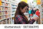 young mom buys baby food in... | Shutterstock . vector #587386595
