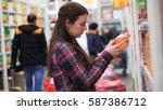 woman buys juice in supermarket ... | Shutterstock . vector #587386712