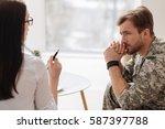 cheerless handsome soldier... | Shutterstock . vector #587397788