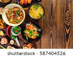 asian food served on old wooden ... | Shutterstock . vector #587404526