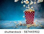 boxes of popcorn on blue... | Shutterstock . vector #587445902
