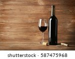 wine bottle and glass on wooden ... | Shutterstock . vector #587475968