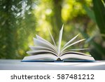 close up of open book at home... | Shutterstock . vector #587481212