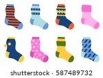 flat design colorful socks set... | Shutterstock .eps vector #587489732
