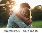 smiling little girl hugging her ... | Shutterstock . vector #587516615