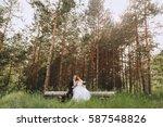 wedding couple in the woods ... | Shutterstock . vector #587548826