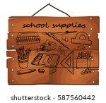 school supplies hand drawn on... | Shutterstock .eps vector #587560442