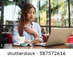 asian woman drinking coffee in... | Shutterstock . vector #587572616