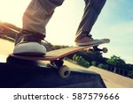 young skateboarder legs riding... | Shutterstock . vector #587579666