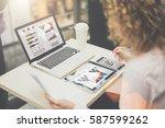 rear view young businesswoman... | Shutterstock . vector #587599262