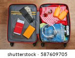 open suitcase with travel... | Shutterstock . vector #587609705