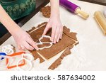 cutting out dough for shaped as ... | Shutterstock . vector #587634002