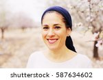 outdoor portrait of 40 years... | Shutterstock . vector #587634602