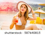 woman holding a fruit cocktail... | Shutterstock . vector #587640815