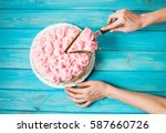 woman's hands cut the cake with ... | Shutterstock . vector #587660726