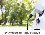 charging battery of an electric ... | Shutterstock . vector #587698025