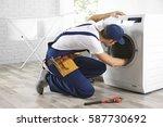 plumber repairing washing...   Shutterstock . vector #587730692