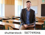 portrait of happy teacher in... | Shutterstock . vector #587749046