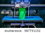 3d printer works and creates an ... | Shutterstock . vector #587751152