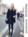 Small photo of PARIS-JANUARY 28, 2015. Stylist Alexandra Golovanoff is going to Jean-Paul Gaultier fashion show. Paris fashion week.