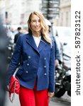 Small photo of PARIS-JULY 8, 2015. Stylist Alexandra Golovanoff is going to a fashion show. Paris fashion week.