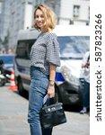 Small photo of PARIS-JULY 6, 2016. Stylist Alexandra Golovanoff is going to a fashion show. Paris fashion week.
