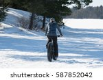 female winter cycling on a fat... | Shutterstock . vector #587852042