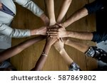 human hands together holding... | Shutterstock . vector #587869802