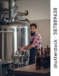 indian bearded tattooed hipster ... | Shutterstock . vector #587889638
