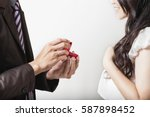 man makes marriage proposal to... | Shutterstock . vector #587898452