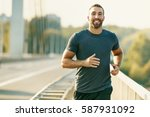 handsome young man running... | Shutterstock . vector #587931092