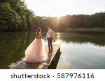wedding couple walking on...   Shutterstock . vector #587976116
