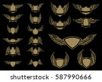 set of winged emblems in golden ... | Shutterstock .eps vector #587990666