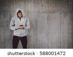 young man in sportswear using... | Shutterstock . vector #588001472