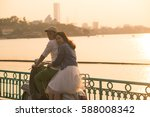 a couple with scooter near west ...   Shutterstock . vector #588008342