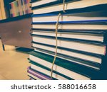 pile of old books with rope... | Shutterstock . vector #588016658